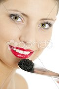 Portrait of woman with black caviar Stock Photos