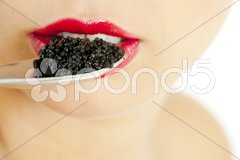 Detail of woman with black caviar Stock Photos