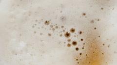 Light beer foam in a glass (closeup) Stock Footage