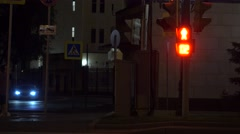 Pedestrian traffic light turns green. Crosswalk at night. 4K shot Stock Footage