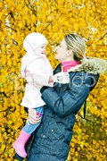 Portrait of woman with toddler in autumnal nature Stock Photos