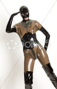 Standing woman wearing latex clothes Stock Photos