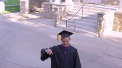 Slow motion of man throwing his graduation cap Stock Footage