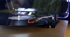 Stylus lowering onto spinning record, surface level close up, shot on R3D Stock Footage