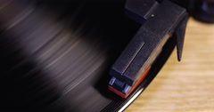 Overhead detail of a record player stylus on spinning record, shot on R3D Stock Footage