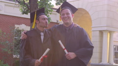 Portrait of friends with diplomas Stock Footage