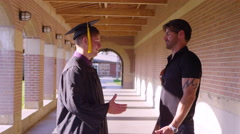 Father and son in graduation gown Stock Footage