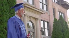 Professor handing a graduate a diploma Stock Footage