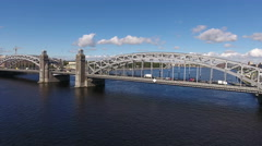 Bolsheokhtinsky bridge across Neva river, Malaya Okhta district, St. Petersburg Stock Footage