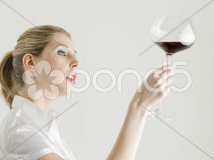 Portrait of young woman with a glass of red wine Stock Photos