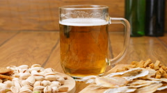 The composition of beer, crackers, pistachios, dried fish (No 3.3, Dolly) Stock Footage