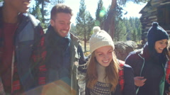 Excited friends hiking past a cabin in a forest, close up, shot on R3D Stock Footage
