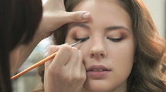 Professional makeup for the brown-haired model Stock Footage