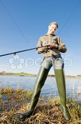 Woman fishing at a pond Stock Photos