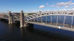 Bolsheokhtinsky Bridge across the Neva river in St. Petersburg, Russia. Aerial Stock Footage