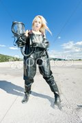 Standing woman with gas mask wearing protective clothes Stock Photos