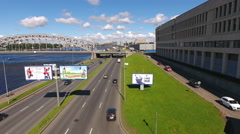 Vehicles drive on six lane road of the Malookhtinsky embankment, St. Petersburg Stock Footage