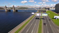 Car traffic is on the Malookhtinsky embankment. St. Petersburg, Russia Stock Footage