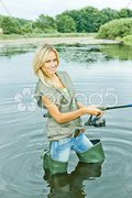 Woman fishing in pond Stock Photos