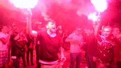 Young people holding torches and celebrate the victory of their national team Stock Footage