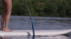 Stand up paddle board close up slow motion Stock Footage