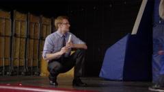Teacher giving diplomas to small children graduates Stock Footage
