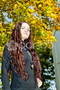 Portrait of young woman in autumnal nature Stock Photos