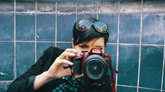 Modern girl with red camera in bleu background Stock Footage