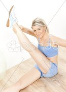 Young woman doing excercises Stock Photos