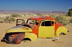 Abandoned wreck in Namib desert Stock Photos