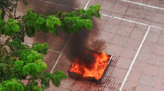 Close Petrol Burns in Vessel at Fire Brigade Exercises in Street Stock Footage
