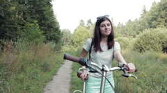 Girl in Sunglasses With a Bike Stock Footage