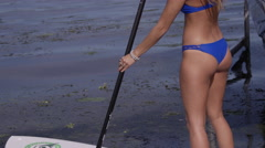 Stand up paddle board slow motion Stock Footage