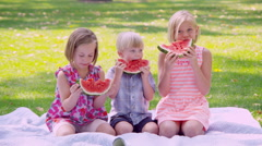 Portrait of children eating watermelon slices Stock Footage