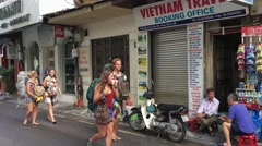 Tourists group walking at Hanoi downtown Stock Footage