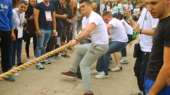 "Men compete in a rope pulling"" ""Tug Of War"" on sport games Stock Footage"