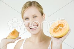 Portrait of woman with water melon Stock Photos