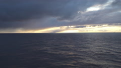Aerial shot of open ocean at sunset - arctic sunlight and dark water Stock Footage