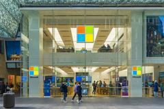 Pedestrians passing by Microsoft flagship store in Sydney Stock Photos