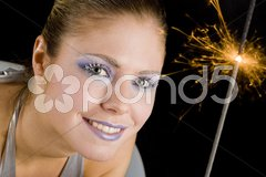 Portrait of woman with fire-cracker Stock Photos