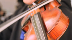 Musician playing the violin on stage at concert Stock Footage