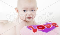 Portrait of naked baby with a heart Stock Photos