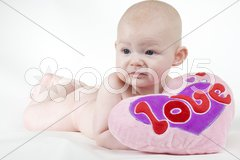 Naked baby with a heart Stock Photos