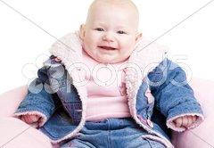 Sitting baby girl Stock Photos