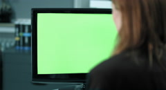 4K: A female employee works on a computer greenkey screen Stock Footage