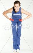 Woman exercising with dumb bells Stock Photos