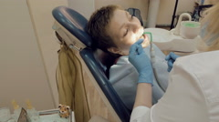 Woman at the dentist medical clinic office Stock Footage