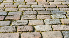 Pan of cobbled stones Stock Footage