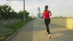 Runner woman running in city exercising outdoors. Stock Footage