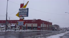 A Motor Lodge along a snow covered road during a winter snow storm. Stock Footage